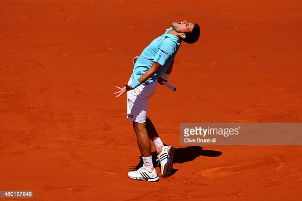 Novak Djokovic of Serbia reacts during his men's singles semifinal match against Ernests Gulbis of Latvia on day thirteen of the French Open at...