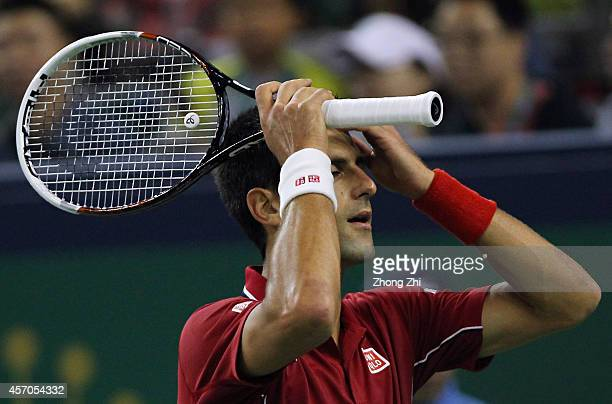 Novak Djokovic of Serbia reacts during his semi final match against Roger Federer of Switzerland during the day 7 of the Shanghai Rolex Masters at...