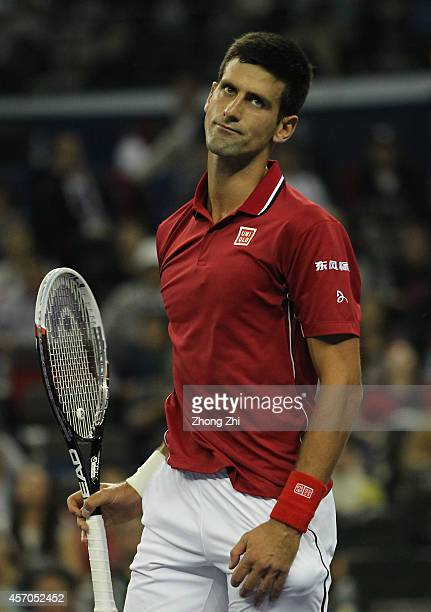 Novak Djokovic of Serbia reacts during his semi final match defeat against Roger Federer of Switzerland during the day 7 of the Shanghai Rolex...