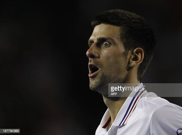 Novak Djokovic of Serbia reacts during his semifinal men's singles match against Andy Murray of Britain on the twelfth day of the Australian Open...