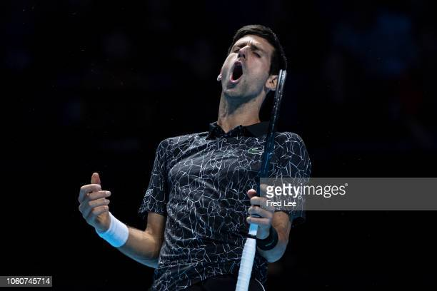 Novak Djokovic of Serbia reacts during his singles round robin match against John Isner of The United States during Day Two of the Nitto ATP Finals...