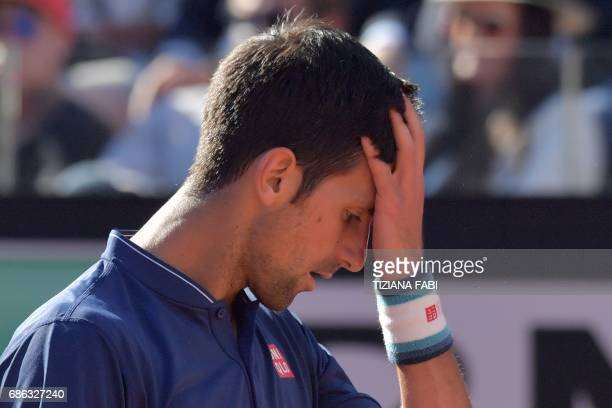 TOPSHOT Novak Djokovic of Serbia reacts during the ATP Tennis Open final against Alexander Zverev of Germany on May 21 2017 at the Foro Italico in...