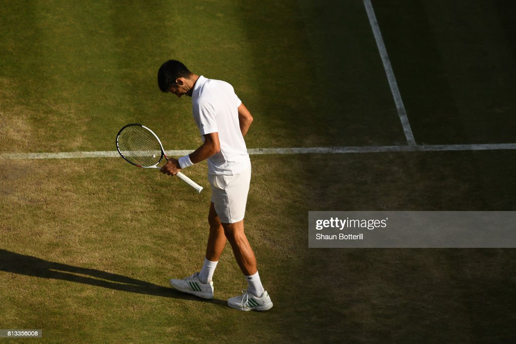 Novak Djokovic of Serbia reacts during the Gentlemen's Singles quarter final match against Tomas Berdych of The Czech Republic on day nine of the Wimbledon Lawn Tennis Championships at the All England Lawn Tennis and Croquet Club on July 12, 2017 in London, England.