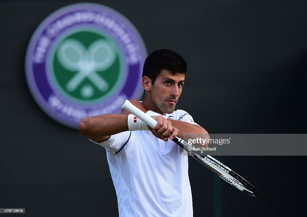Novak Djokovic of Serbia reacts in his Gentlemen's Singles Fourth Round match against Kevin Anderson of South Africa during day seven of the Wimbledon Lawn Tennis Championships at the All England Lawn Tennis and Croquet Club on July 6, 2015 in London, England.