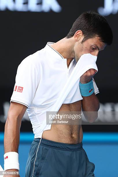 Novak Djokovic of Serbia reacts in his second round match against Denis Istomin of Uzbekistan on day four of the 2017 Australian Open at Melbourne...