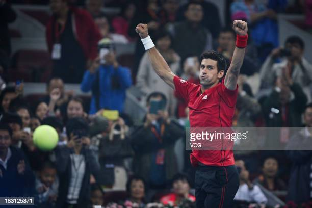 Novak Djokovic of Serbia reacts in the match against Sam Querrey of the U.S. During day seven of the 2013 China Open at National Tennis Center on...