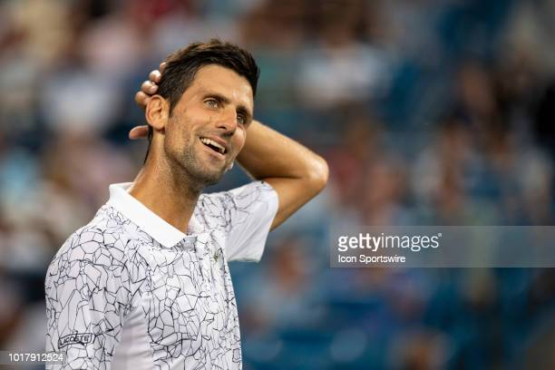 Novak Djokovic of Serbia reacts to a line call while playing Grigor Dimitrov of Bulgaria during Day 5 of the Western and Southern Open at the Lindner...