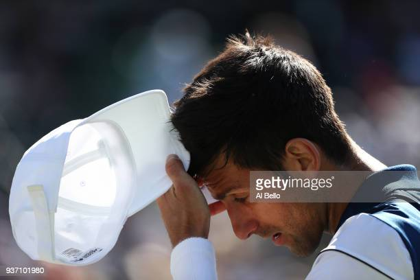 Novak Djokovic of Serbia reacts to a lost point against Benoit Paire of France during Day 5 of the Miami Open at the Crandon Park Tennis Center on...
