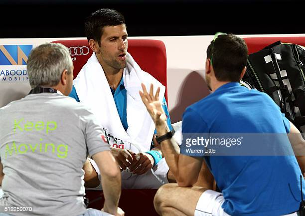 Novak Djokovic of Serbia receives medical attention on court during his quarter final match against Feliciano Lopez of Spain on day six of the ATP...