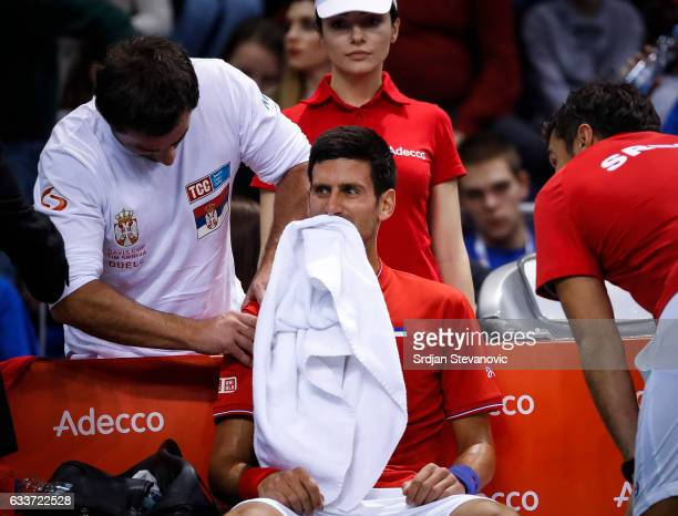 Novak Djokovic of Serbia receives medical treatment during the Davis Cup World Group first round single match between Serbia and Russia at Cair...