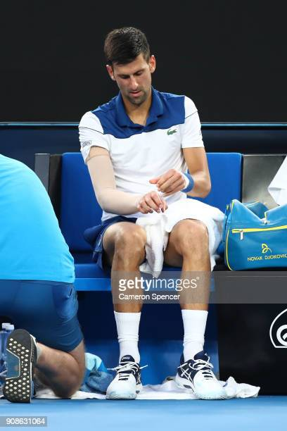Novak Djokovic of Serbia receives medical treatment in his fourth round match against Hyeon Chung of South Korea on day eight of the 2018 Australian...