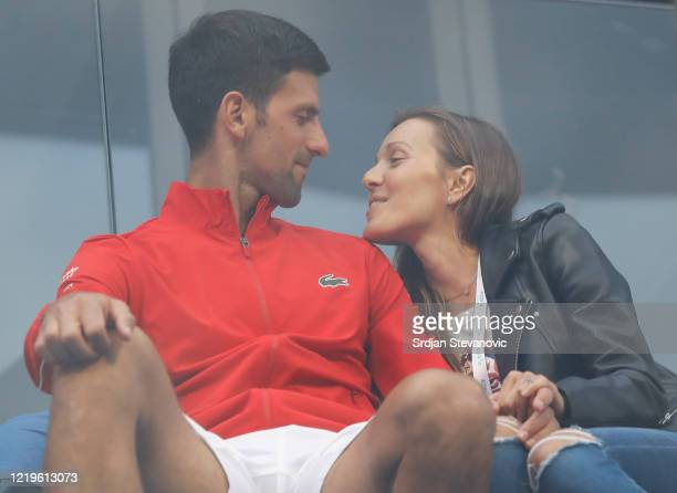 Novak Djokovic of Serbia relaxes with his wife Jelena Djokovic after the exhibition doubles match of the Adria Tour charity exhibition hosted by...