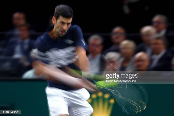 Novak Djokovic of Serbia returns a backhand in his match against Kyle Edmund of Great Britain on day 4 of the Rolex Paris Masters, part of the ATP...