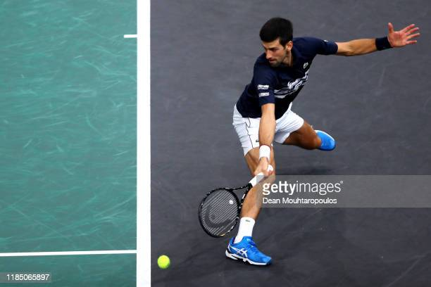 Novak Djokovic of Serbia returns a backhand in his semi final match against Grigor Dimitrov of Bulgaria on day 6 of the Rolex Paris Masters, part of...