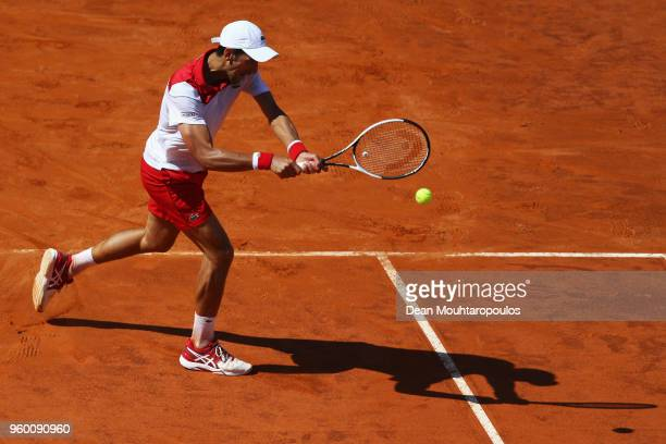 Novak Djokovic of Serbia returns a backhand in his semi final match against Rafael Nadal of Spain during day 7 of the Internazionali BNL d'Italia...