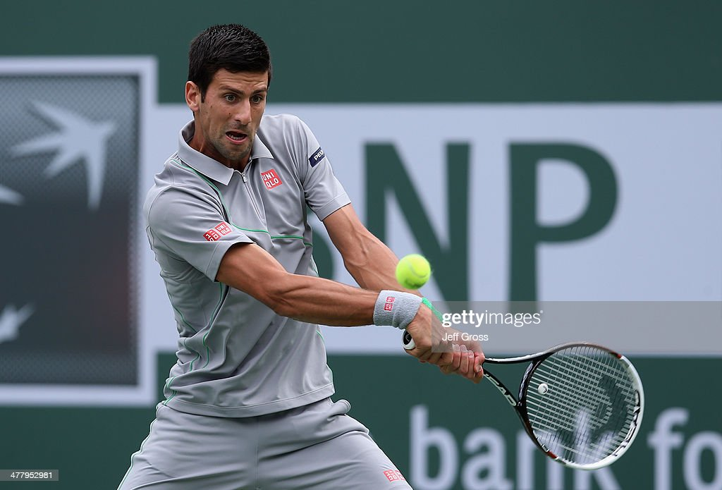 Novak Djokovic of Serbia returns a backhand to Alejandro Gonzalez of Colombia during the BNP Paribas Open at Indian Wells Tennis Garden on March 11, 2014 in Indian Wells, California.