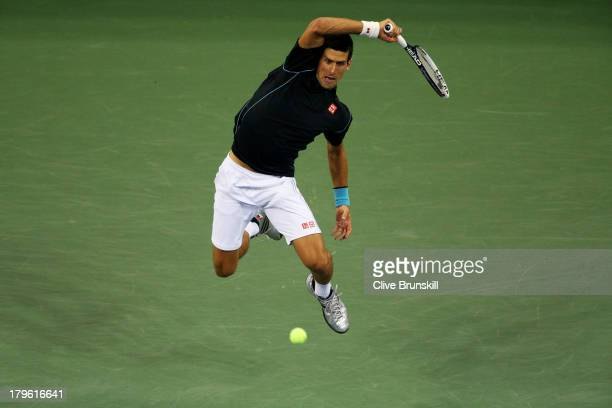 Novak Djokovic of Serbia returns a forehand during his quarterfinal match against Mikhail Youzhny of Russia on Day Eleven of the 2013 US Open at USTA...