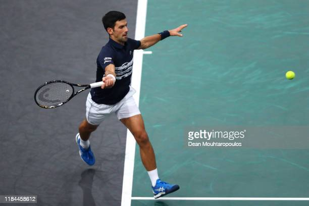 Novak Djokovic of Serbia returns a forehand in his match against Corentin Moutet of France on day 3 of the Rolex Paris Masters part of the ATP World...