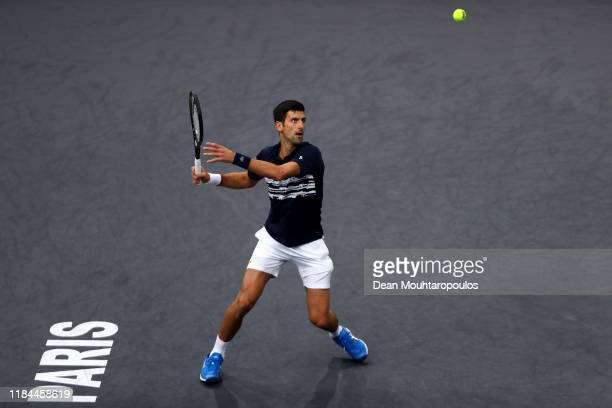 Novak Djokovic of Serbia returns a forehand in his match against Corentin Moutet of France on day 3 of the Rolex Paris Masters, part of the ATP World...
