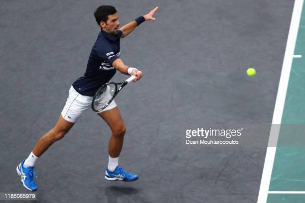 Novak Djokovic of Serbia returns a forehand in his semi final match against Grigor Dimitrov of Bulgaria on day 6 of the Rolex Paris Masters, part of...