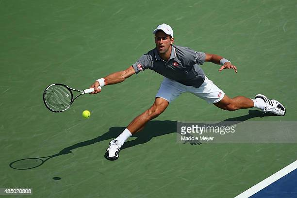 Novak Djokovic of Serbia returns a forehand to Roger Federer of Switzerland during the final round on Day 9 of the Western & Southern Open at the...