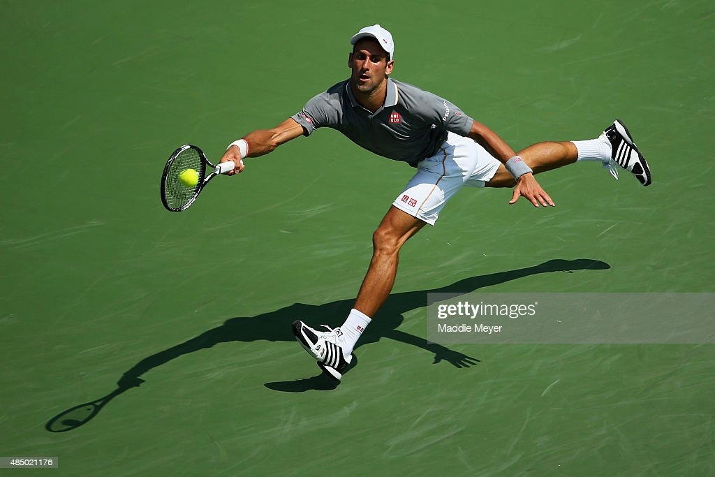 Novak Djokovic of Serbia returns a forehand to Roger Federer of Switzerland during the final round on Day 9 of the Western & Southern Open at the Lindner Family Tennis Center on August 23, 2015 in Cincinnati, Ohio.