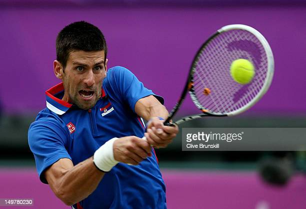 Novak Djokovic of Serbia returns a shot against Andy Murray of Great Britain in the Semifinal of Men's Singles Tennis on Day 7 of the London 2012...