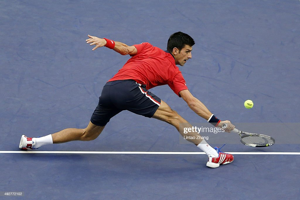 Novak Djokovic of Serbia returns a shot against Feliciano Lopez of Spain during the men's singles third round match on day 5 of Shanghai Rolex Masters at Qi Zhong Tennis Centre on October 15, 2015 in Shanghai, China.