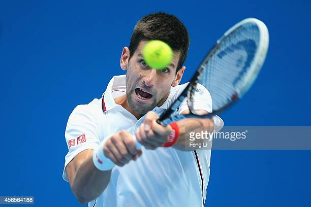 Novak Djokovic of Serbia returns a shot against Grigor Dimitrov of Bulgaria during day seven of the China Open at the National Tennis Center on...