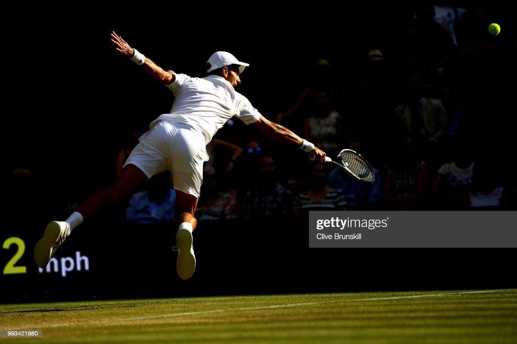 Novak Djokovic of Serbia returns a shot against Kyle Edmund of Great Britain during their Men's Singles third round match on day six of the Wimbledon Lawn Tennis Championships at All England Lawn Tennis and Croquet Club on July 7, 2018 in London, England.