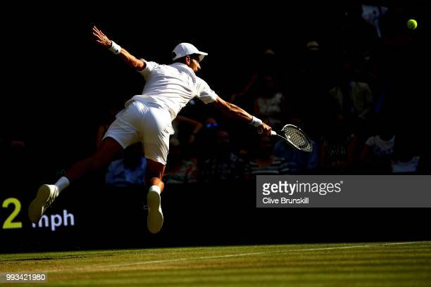 Novak Djokovic of Serbia returns a shot against Kyle Edmund of Great Britain during their Men's Singles third round match on day six of the Wimbledon...