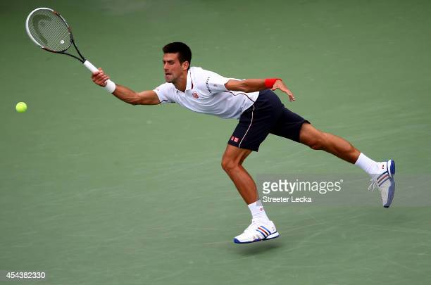 Novak Djokovic of Serbia returns a shot against Sam Querrey of the United States during their men's singles third round match on Day Six of the 2014...