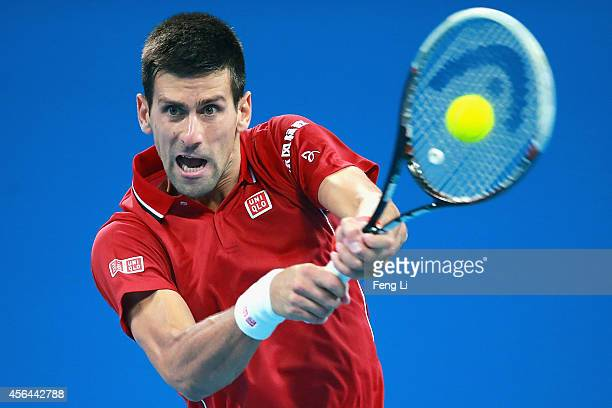 Novak Djokovic of Serbia returns a shot against Vasek Pospisil of Canada during day five of the China Open at the China National Tennis Center on...
