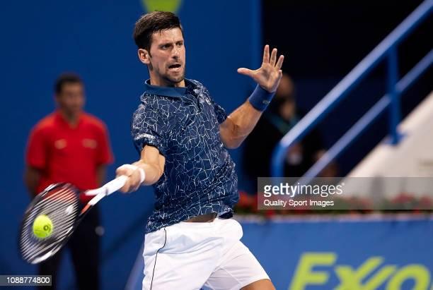 Novak Djokovic of Serbia returns a shot during his match against Damir Dzumhur of Bosnia and Herzegovina during day two of the ATP Qatar ExxonMobil...