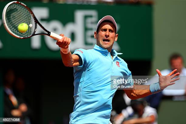 Novak Djokovic of Serbia returns a shot during his men's singles final match against Rafael Nadal of Spain on day fifteen of the French Open at...
