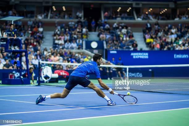Novak Djokovic of Serbia returns a shot during his Men's Singles second round match against against Juan Ignacio Londero of Argentina on day three of...