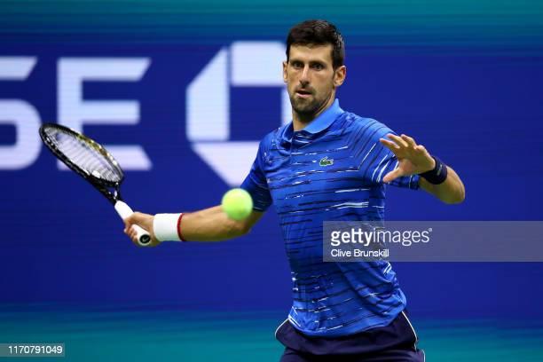 Novak Djokovic of Serbia returns a shot during his Men's Singles second round match against Juan Ignacio Londero of Argentina on day three of the...