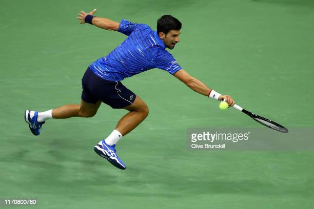 Novak Djokovic of Serbia returns a shot during his Men's Singles second round match against Juan Ignacio Londero of Argentina on day three of the...