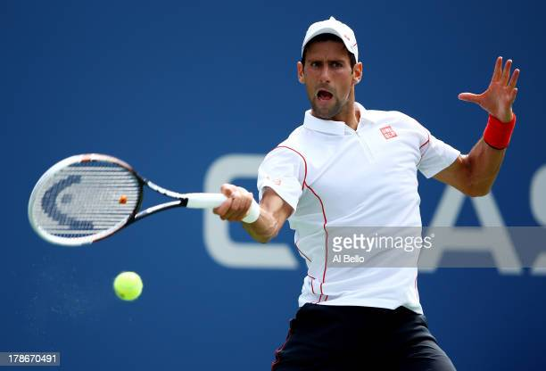 Novak Djokovic of Serbia returns a shot during his men's singles second round match against Benjamin Becker of Germany on Day Five of the 2013 US...