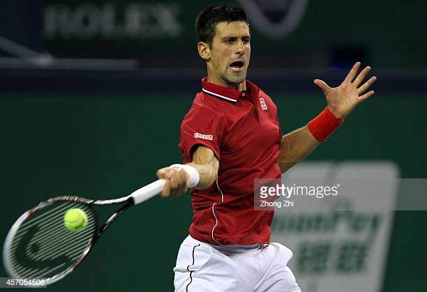 Novak Djokovic of Serbia returns a shot during his semi final match against Roger Federer of Switzerland during the day 7 of the Shanghai Rolex...