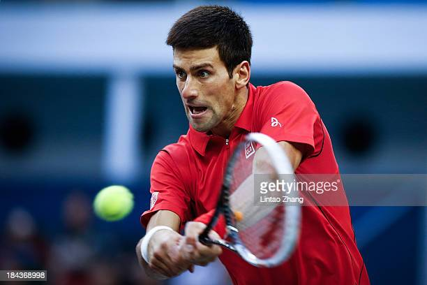 Novak Djokovic of Serbia returns a shot during the final match against Juan Martin Del Potro of Argentina on day seven of the Shanghai Rolex Masters...
