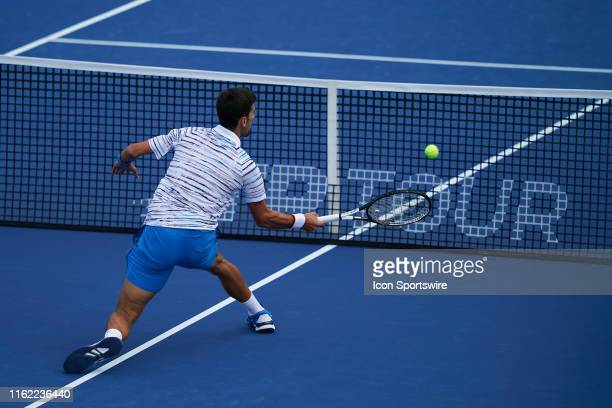 Novak Djokovic of Serbia returns a shot during the semifinal round of the Western & Southern Open at Lindner Family Tennis Center on August 17, 2019...