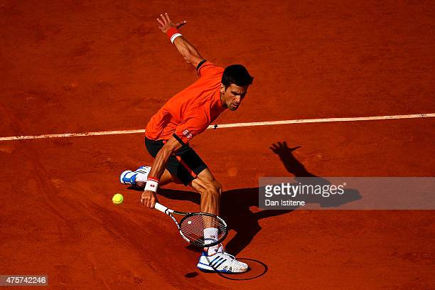 Novak Djokovic of Serbia returns a shot in his Men's quarter final match against Rafael Nadal of Spain on day eleven of the 2015 French Open at...