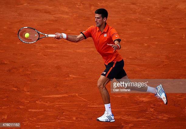 Novak Djokovic of Serbia returns a shot in his Men's Semi Final match against Andy Murray of Great Britain on day thirteen of the 2015 French Open at...