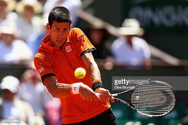 Novak Djokovic of Serbia returns a shot in his Men's Semi Final match against Andy Murray of Great Britain on day fourteen of the 2015 French Open at...