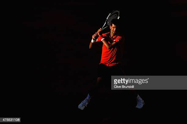 Novak Djokovic of Serbia returns a shot in his Men's Singles match against Richard Gasquet of France on day nine of the 2015 French Open at Roland...