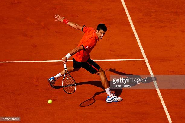 Novak Djokovic of Serbia returns a shot in the Men's Singles Final against Stanislas Wawrinka of Switzerland on day fifteen of the 2015 French Open...