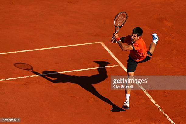 Novak Djokovic of Serbia returns a shot in the Men's Singles Final against Stanislas Wawrinka of Switzerland on day fifteen of the 2015 French Open...