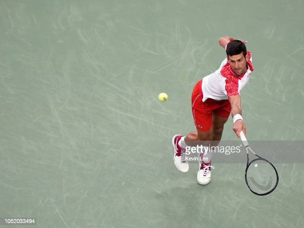 Novak Djokovic of Serbia returns a shot to Alexander Zverev of Germany during the semifinal of men's singles match of the 2018 Rolex Shanghai Masters...