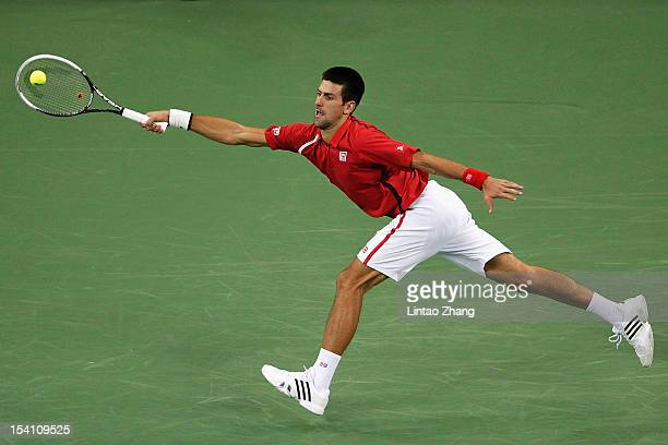 Novak Djokovic of Serbia returns a shot to Andy Murray of Great Britain during the final of the Shanghai Rolex Masters at the Qi Zhong Tennis Center...